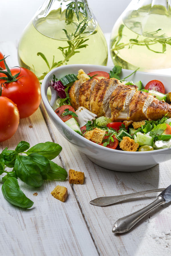 Healthy salad with chicken and olive oil stock photography