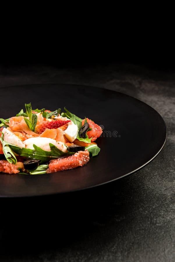 Healthy salad on dark plate.Restaurant dish,healthy eating stock photos
