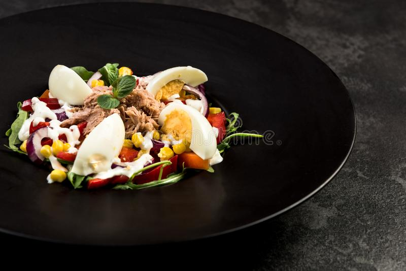 Healthy salad on dark plate.Restaurant dish,healthy eating stock photography