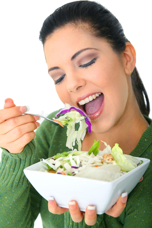 Healthy Salad Meal. Happy young woman eating her salad. healthy lifestyle royalty free stock photo