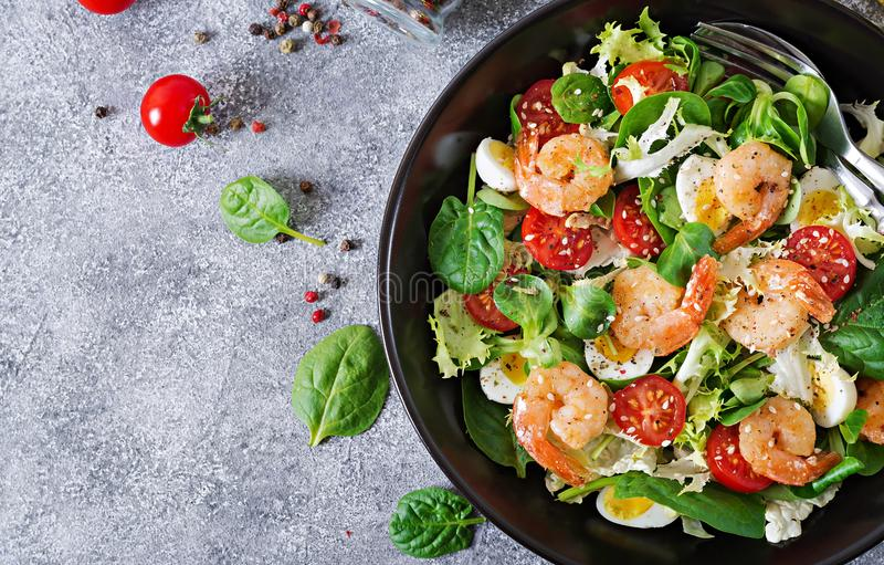 Healthy salad plate. Fresh seafood recipe. Grilled shrimps and fresh vegetable salad and egg. Grilled prawns. Healthy food. Flat l. Ay. Top view stock image