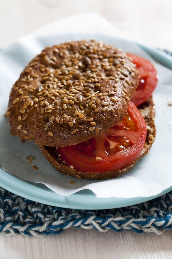 Healthy sandwich. Closeup of healthy tomato grain bread sandwich on plate stock photo