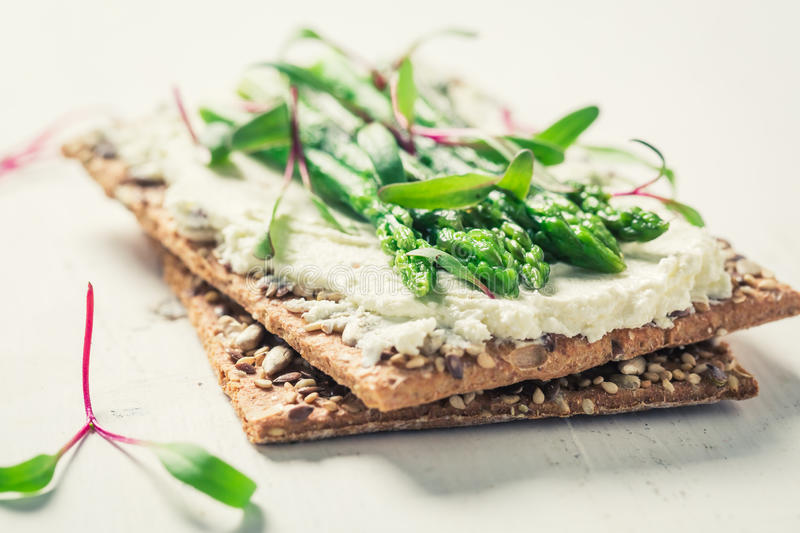 Healthy sandwich with asparagus and fromage cheese. On old white table stock photography