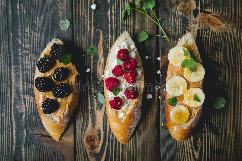 Healthy sandwich with berries and fresh baguett stock photography