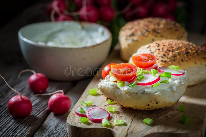 Healthy sandwich with fromage cheese and cherry tomatoes. On dark background stock images