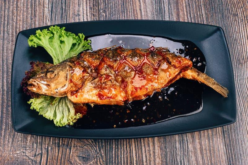Healthy sea bass fish. With green salad royalty free stock photos