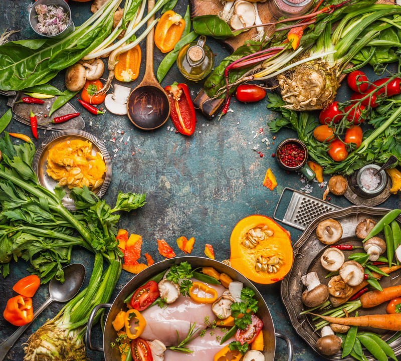 Healthy seasonal food ingredients for tasty clean cooking and eating: organic vegetables,Mushrooms, pumpkin, roots and chicken on. Vintage background, top view royalty free stock photography