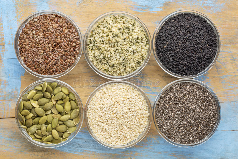 Healthy seed collection in glass bowls stock photos