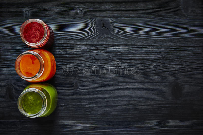 Healthy sign traffic lights out of juices red orange and green. Fresh organic smoothies fit lifestyle graphic explaining healthy diet stock photo