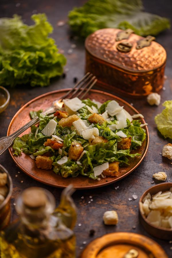 Healthy simple Caesar salad. With cheese and croutons stock photos