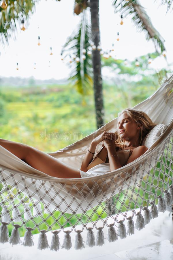 Healthy sleep in the open air at hammock. Sexy woman relaxing stock photo