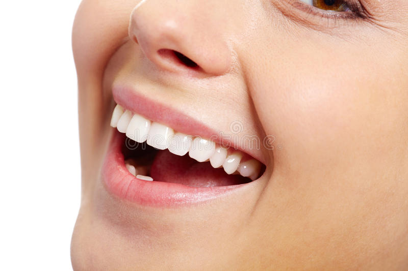 Healthy smile. Close-up of fresh girl with healthy white teeth smiling stock images