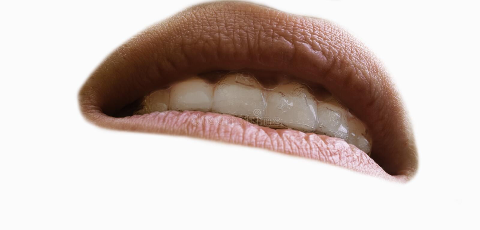 Healthy Smile. Teeth Whitening. Dental care Concept. Woman Smile Closeup. Beautiful Lips and Teeth over white background royalty free stock photo
