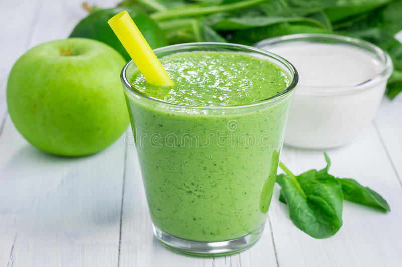 Healthy smoothie with green apple, spinach, lime and coconut milk stock photo