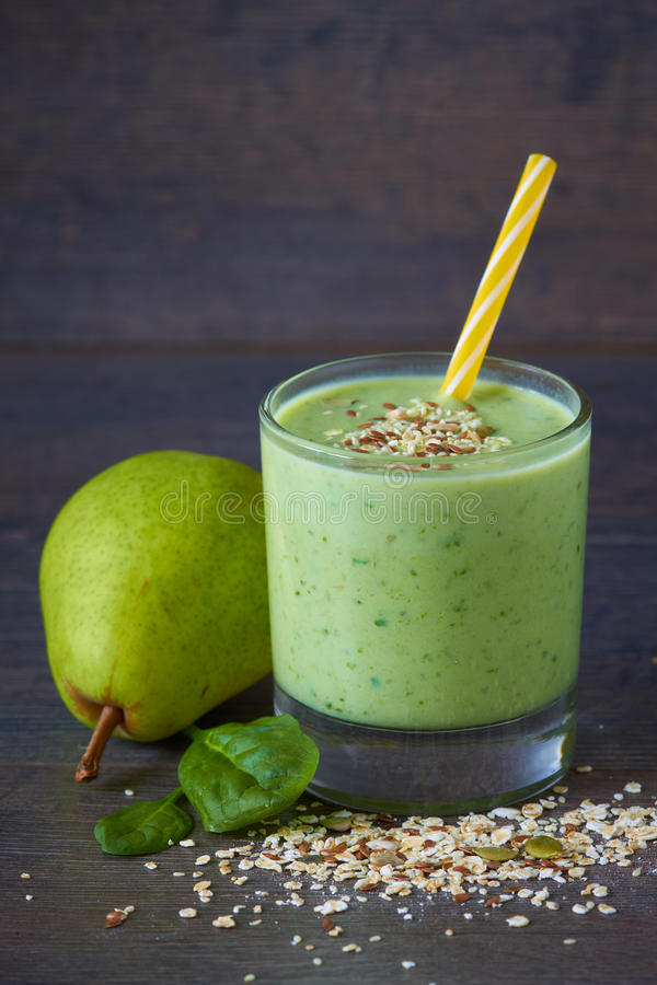 Healthy smoothie. Homemade smoothie made from oats milk, pear, spinach and raw seed stock photos