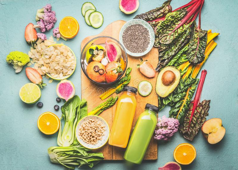 Healthy smoothie ingredients and mix blender on kitchen table, top view. Summer food and beverages background. Vegan superfood: royalty free stock photo