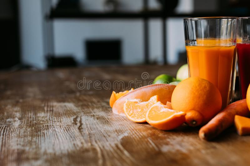 Healthy smoothies with ingredients. Close-up view of healthy smoothies in glasses and fresh ingredients on table royalty free stock photos