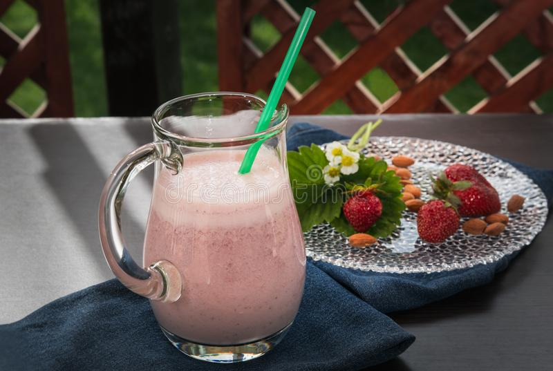 Healthy snack, strawberry smoothie with milk and almonds royalty free stock photos