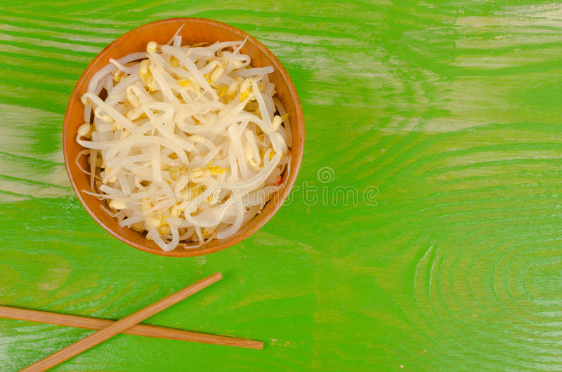 Healthy soy sprouts and chopsticks stock photo