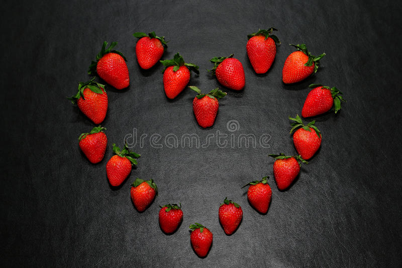 Healthy Strawberries Arranged in Good Heart Shape stock images