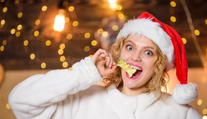 Healthy and strong teeth. happy new year. christmas preparation. woman eat apple. xmas decoration. girl in red santa stock photos