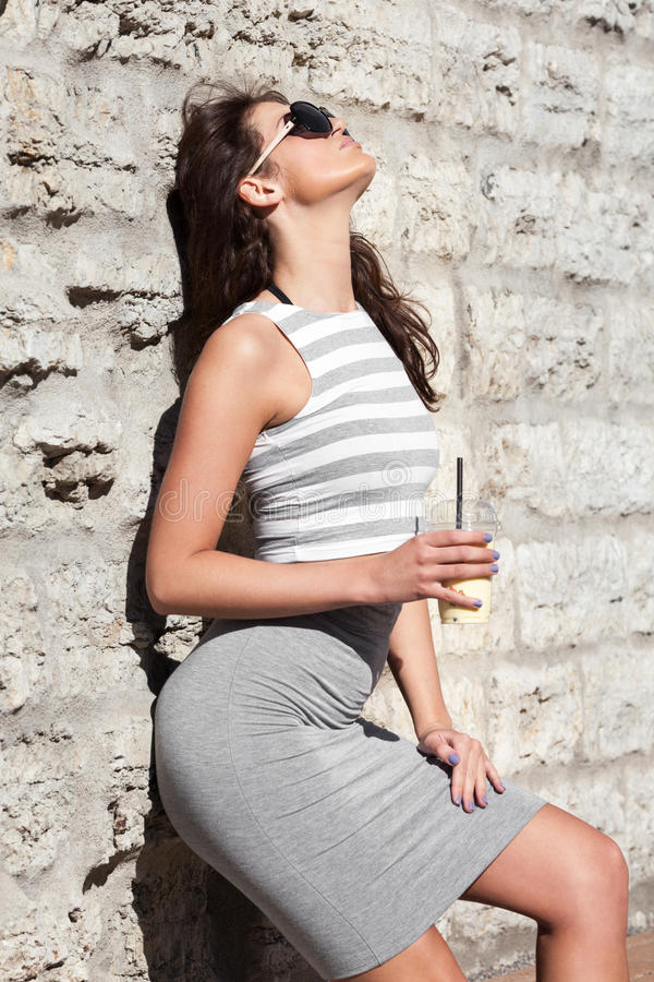 Healthy summer. Attractive city woman with smoothie stock images