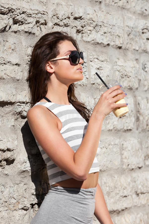 Healthy summer. Attractive city woman with smoothie royalty free stock image