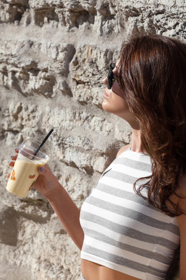 Healthy summer. Attractive city woman with smoothie royalty free stock photography