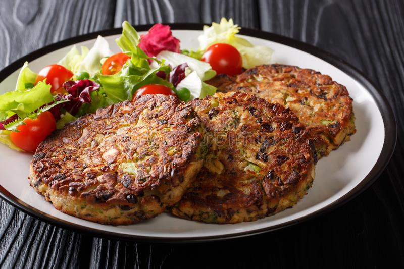 Healthy tasty food mushroom vegetable patty with fresh salad on a plate close-up. horizontal stock image