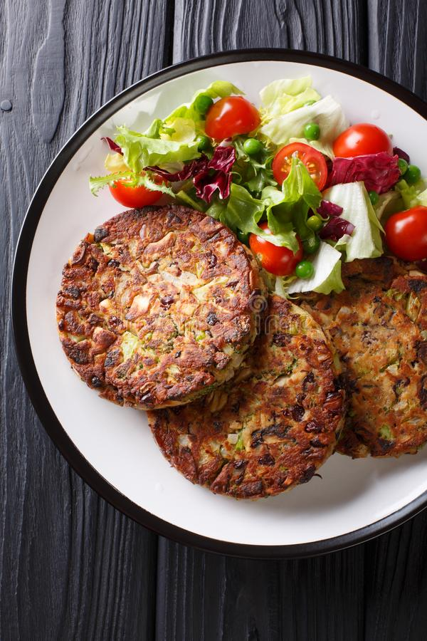 Healthy tasty food mushroom vegetable patty with fresh salad on a plate close-up. Vertical top view royalty free stock photo