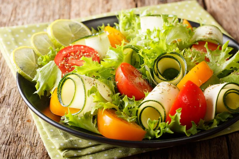 Healthy and tasty food: salad of zucchini, tomatoes, lettuce wit royalty free stock photo