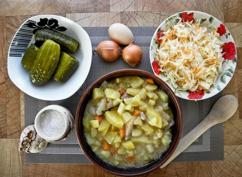 Healthy tasty food, stewed potatoes from the oven, and a snack. royalty free stock photography