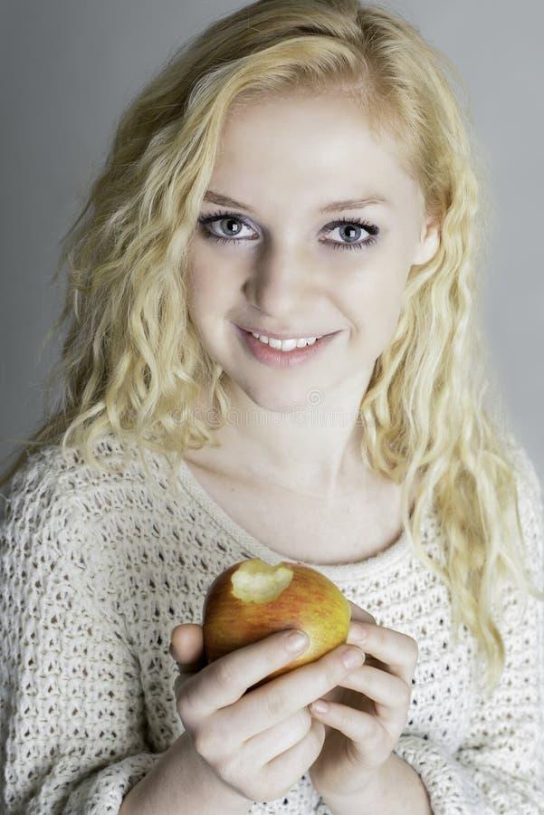 Healthy teen eating an apple
