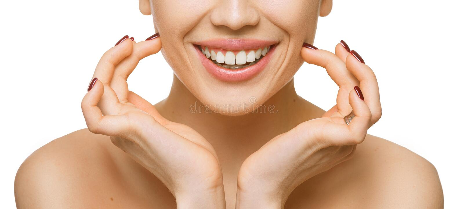 Healthy teeth and smile of a beautiful young woman isolated on white background stock photos