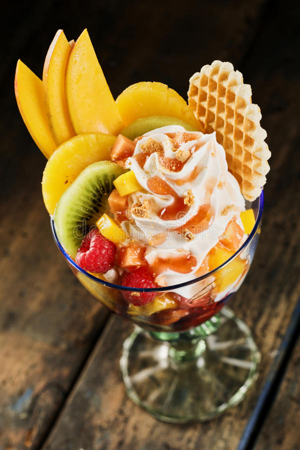 healthy tropical fruit salad with whipped cream stock