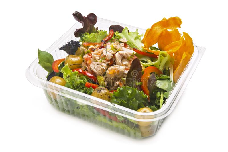 Healthy tuna salad in a takeaway plastic container. Tuna, red pepper in strips, steamed potatoes, assorted lettuce and sweet royalty free stock image