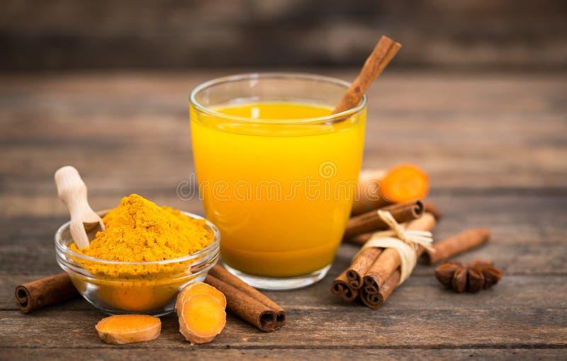 Healthy turmeric drink with honey, cinnamon, lemon and ginger stock image