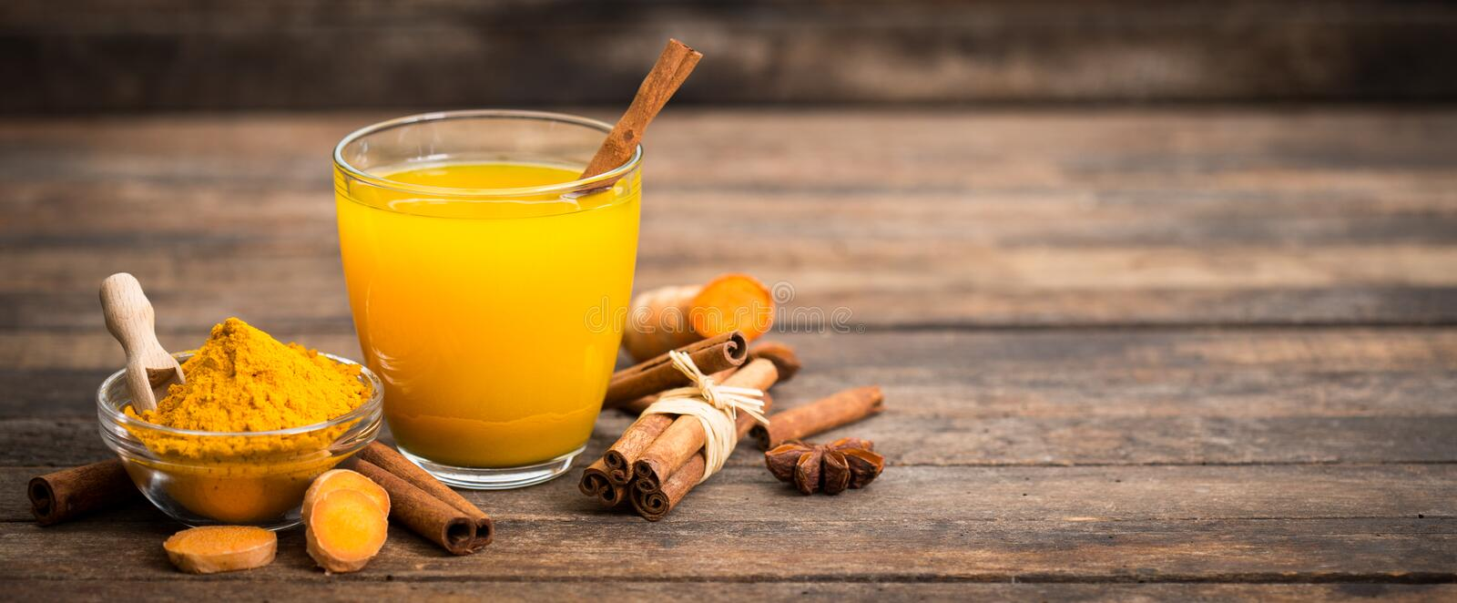 Healthy turmeric drink with honey, cinnamon, lemon and ginger royalty free stock photos