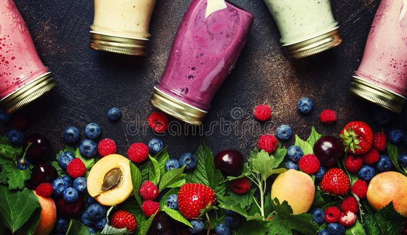 Healthy and useful colorful berry smoothies with yogurt, fresh f royalty free stock photos