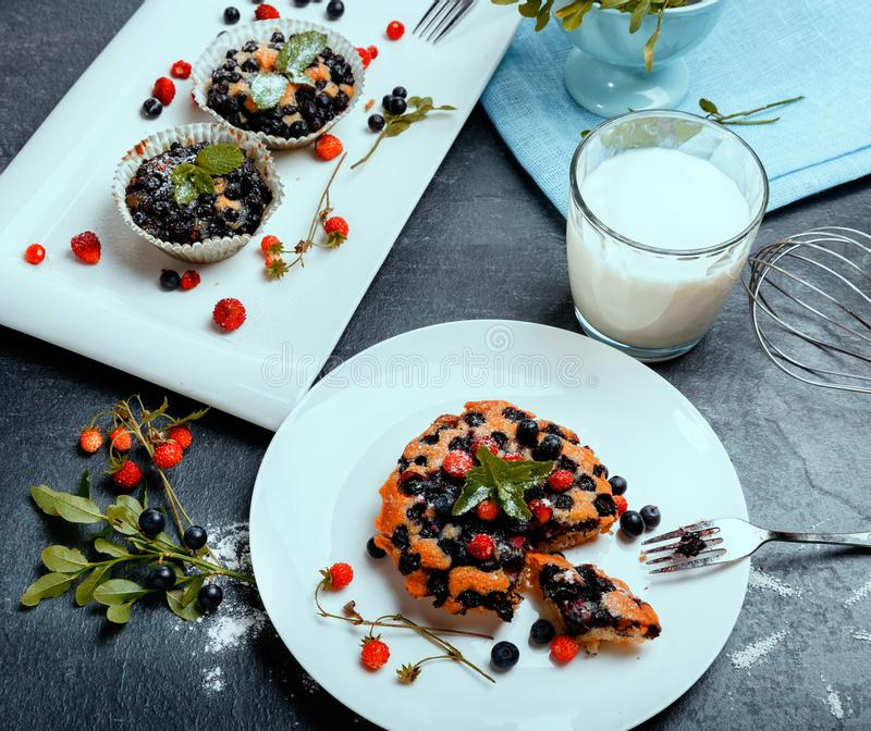 Healthy vegan banana blueberry muffins with fresh berries royalty free stock images