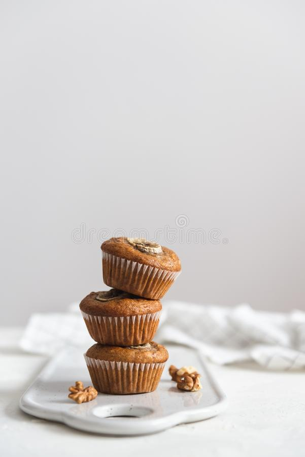 Healthy vegan banana walnut muffins on white background. Side view, copy space royalty free stock photos