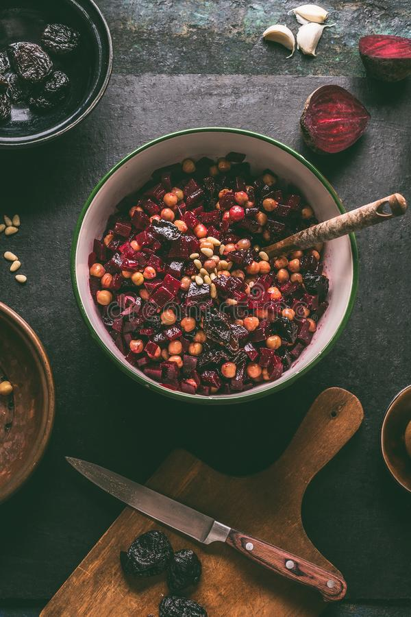 Healthy vegan beetroot salad with chickpeas in bowl on dark kitchen table background, top view. Purple vegetables eating. Clean stock photos