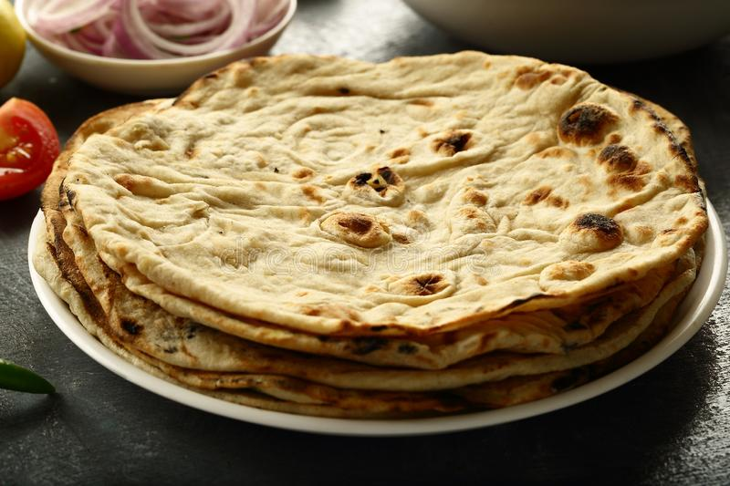 Fresh made Tandoori roti from Indian cuisine. Healthy vegan diet food- homemade roti served with chickpea curry channa masala royalty free stock images