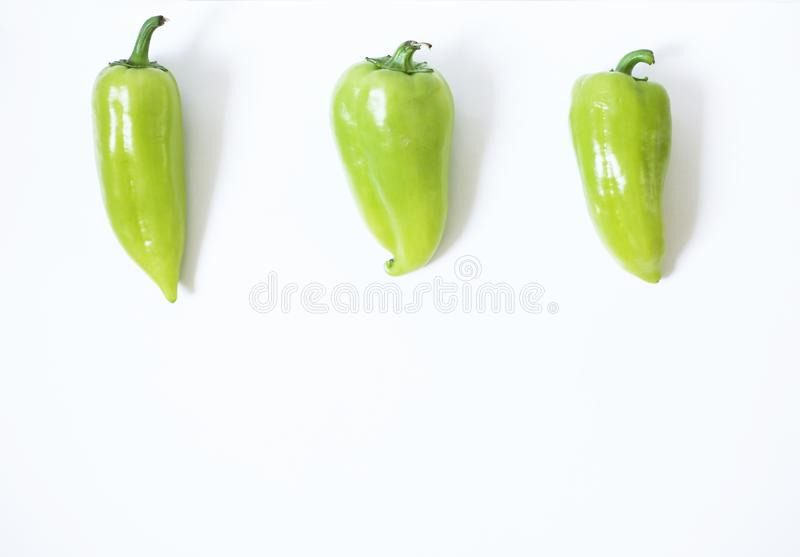 Healthy vegan food concept. green peppers on a white background royalty free stock photos