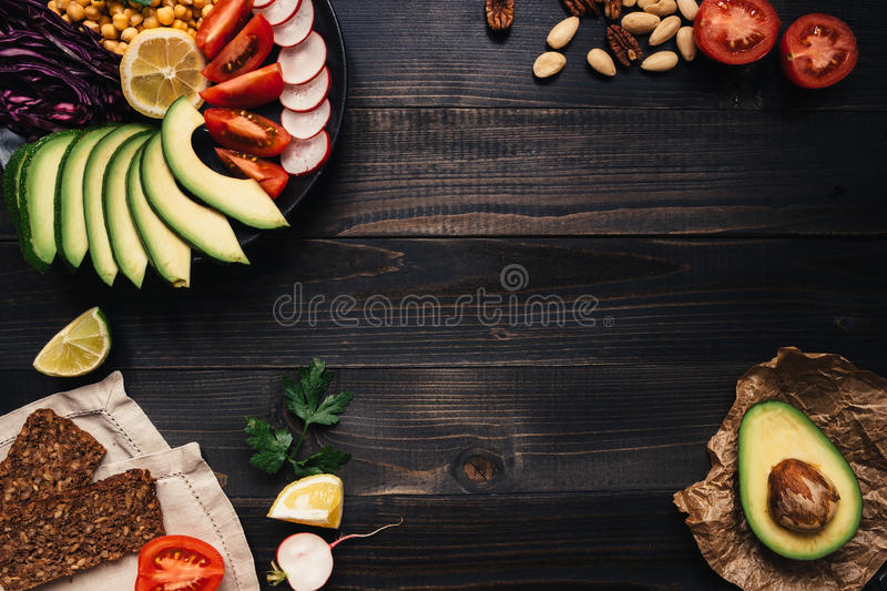Healthy vegan food concept. Healthy food with vegetables and whole wheat bread on the wooden table top view. Copy space.  stock photo