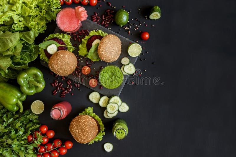 Healthy vegan food. Fresh vegetables on black background. Detox diet. Different colorful fresh juices. Flat lay with copy space. Healthy vegan food. Fresh stock photo