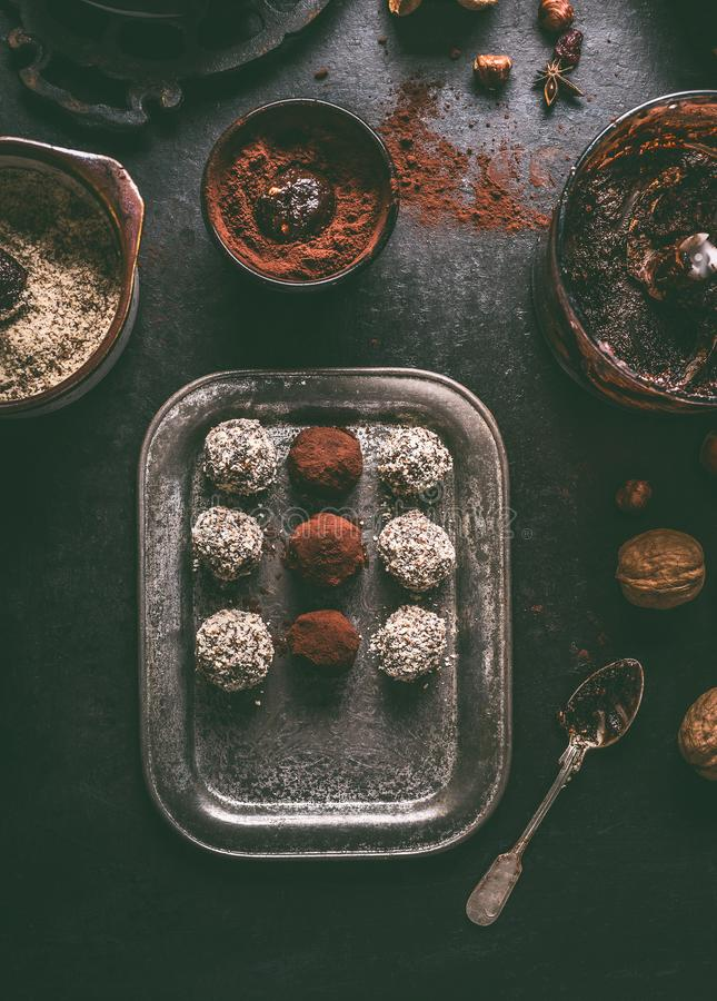 Healthy vegan homemade truffles making. Coated in cacao powder and almond flour truffle balls royalty free stock image