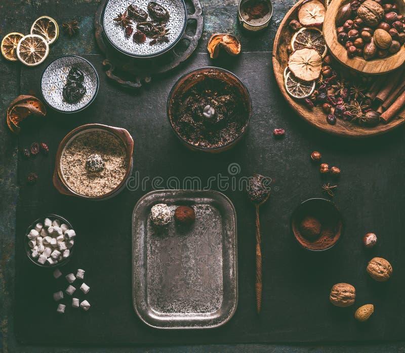 Healthy vegan homemade truffles making preparation on dark background with ingredients royalty free stock photo