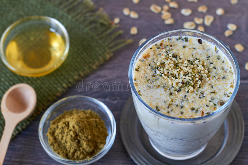 Healthy vegan smoothie. Homemade smoothie made from oats milk and hemp seeds stock photography