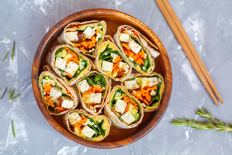 Healthy vegan tofu tortilla wraps with tofu and vegetables royalty free stock photography